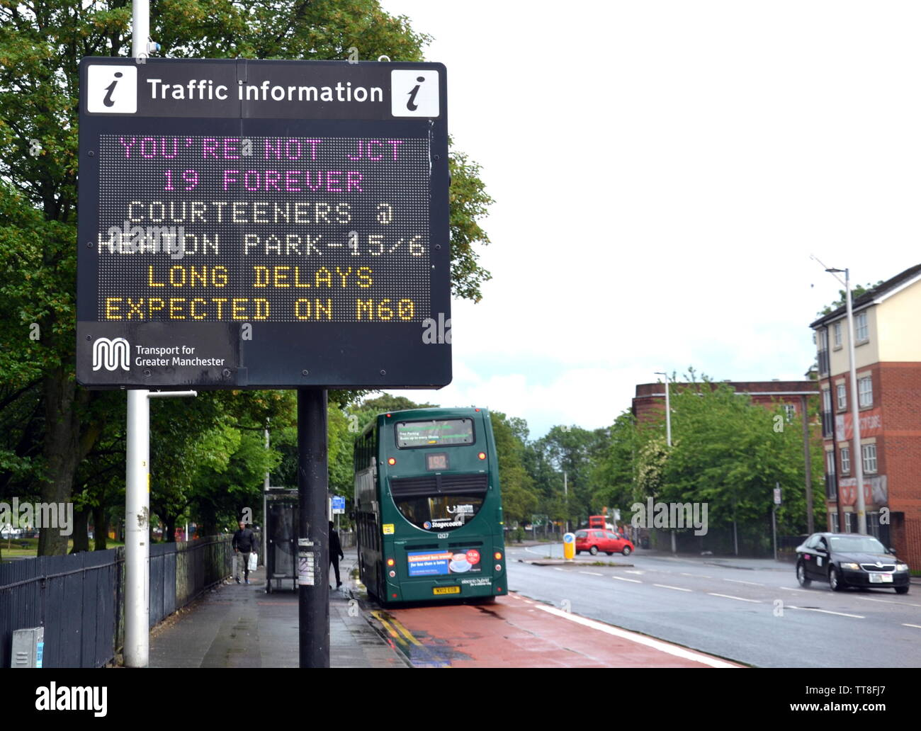 A Manchester, uk, traffic information sign on Ardwick Green South announces the Courteeners concert at Heaton Park, Manchester on June 15, 2019. with a pun on their iconic hit song 'Not Nineteen Forever' : 'You're Not JCT 19 Forever'. The concert has attracted 50,000 fans. Manchester transport chiefs have asked fans to consider walking back to the city centre after the concert. - Stock Image
