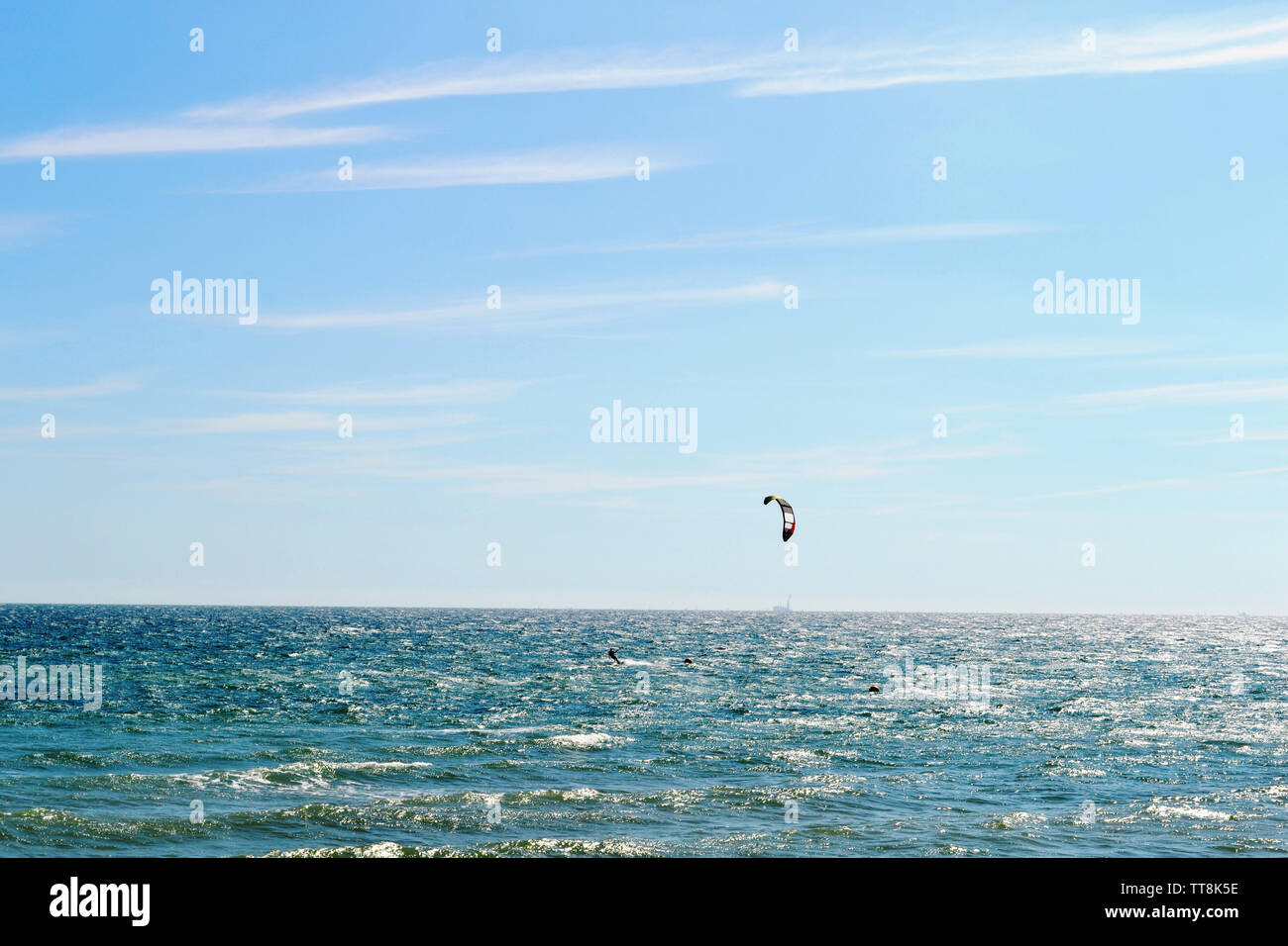 Beautiful seascape view in backlit and kitesurfing in Brighton, England. Stock Photo