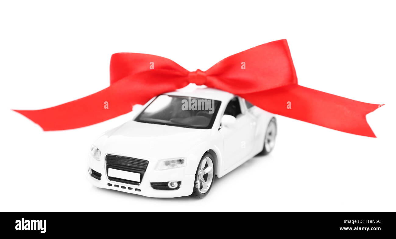 Car with red bow as present isolated on white - Stock Image