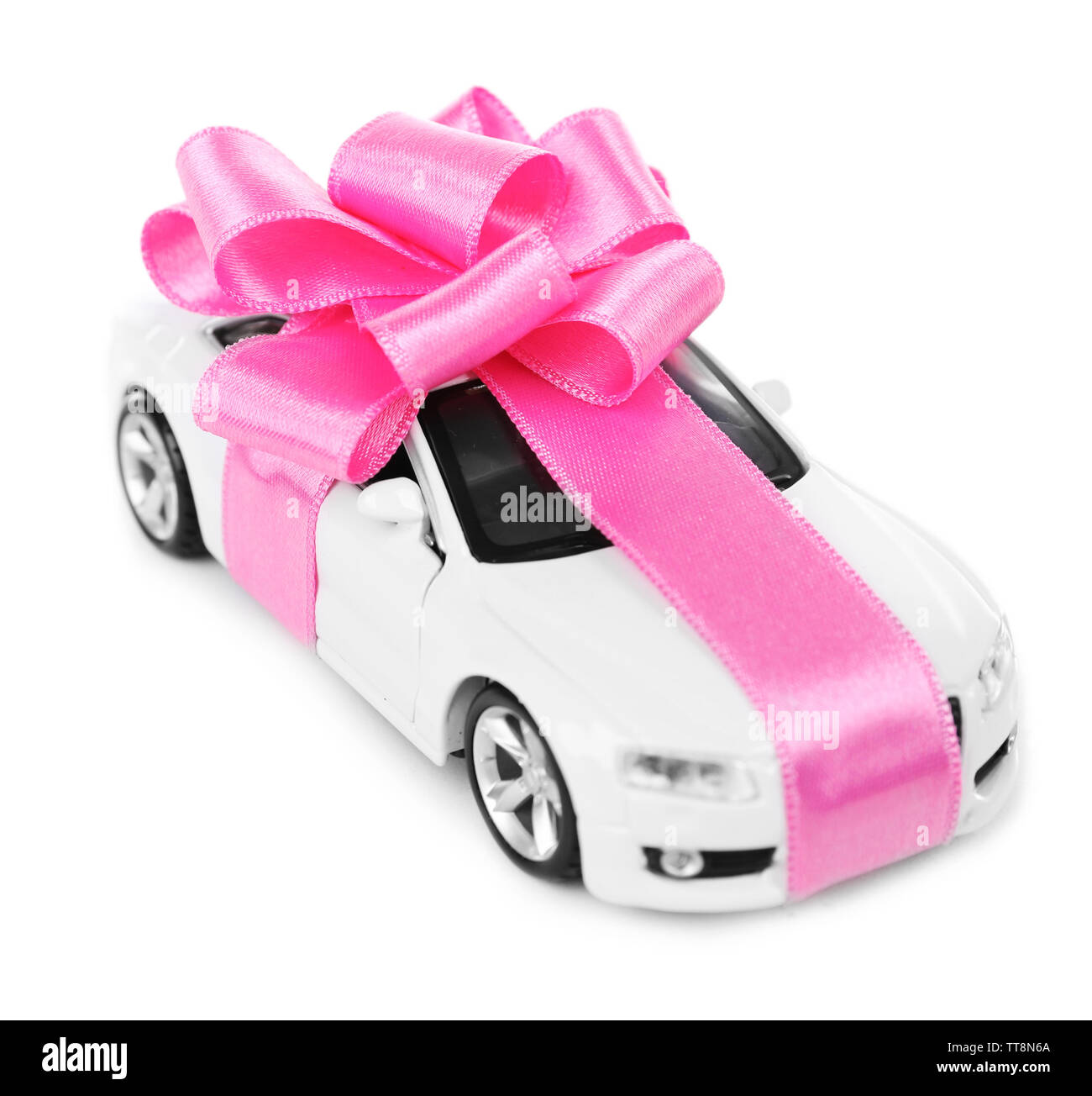 New car with pink bow as present isolated on white - Stock Image
