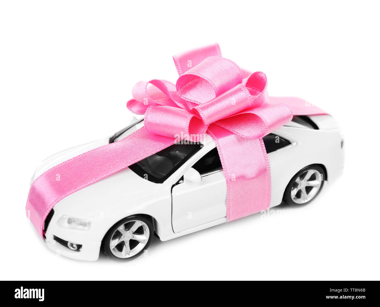 New car with pink bow as present isolated on white Stock Photo
