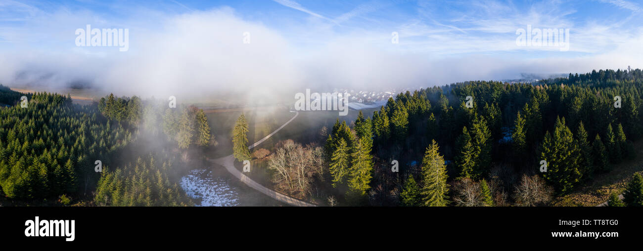 Aerial view out of the clouds - Stock Image