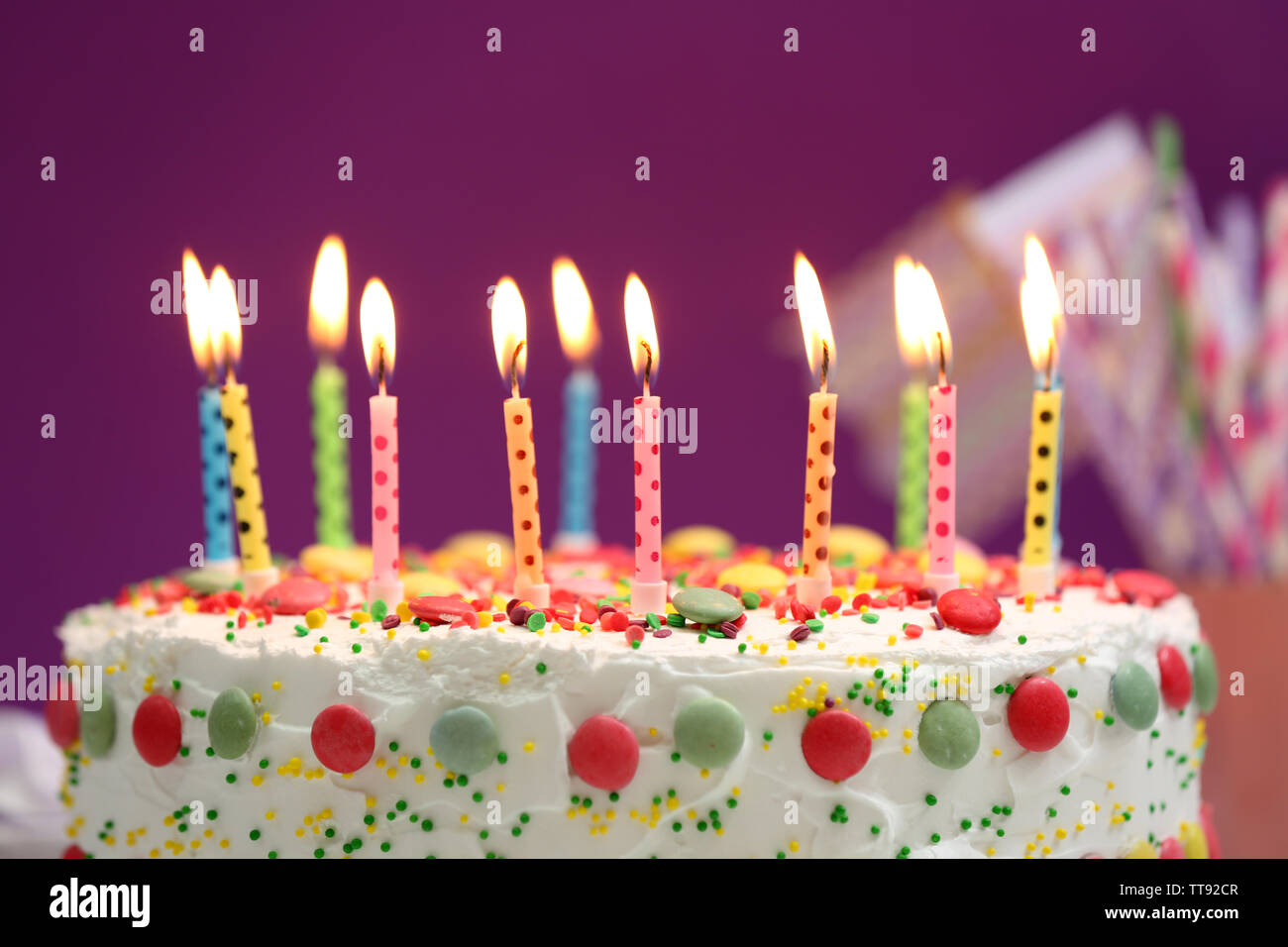 Marvelous Birthday Cake With Candles On Purple Background Stock Photo Funny Birthday Cards Online Chimdamsfinfo