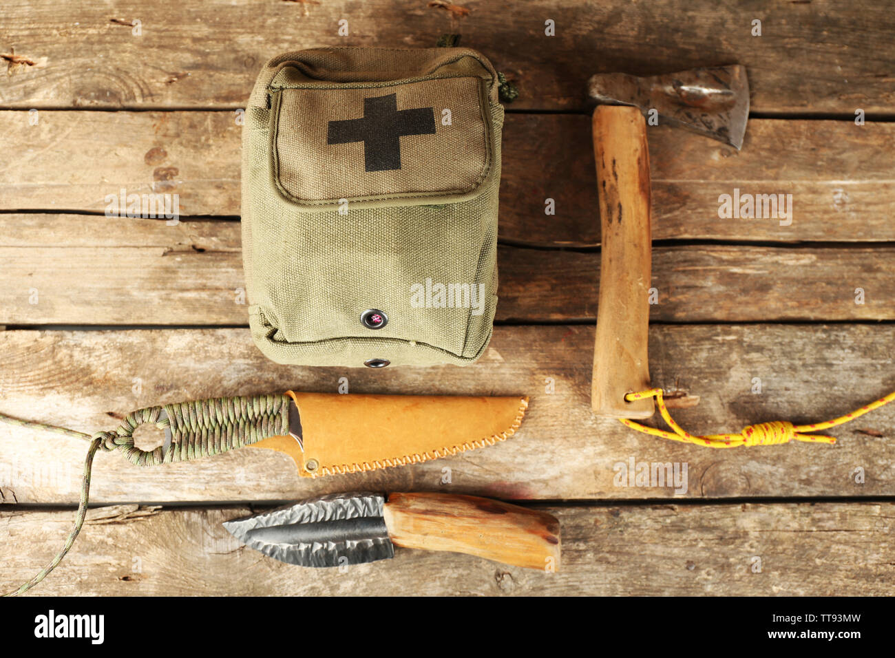 Hiking gear on wooden background - Stock Image