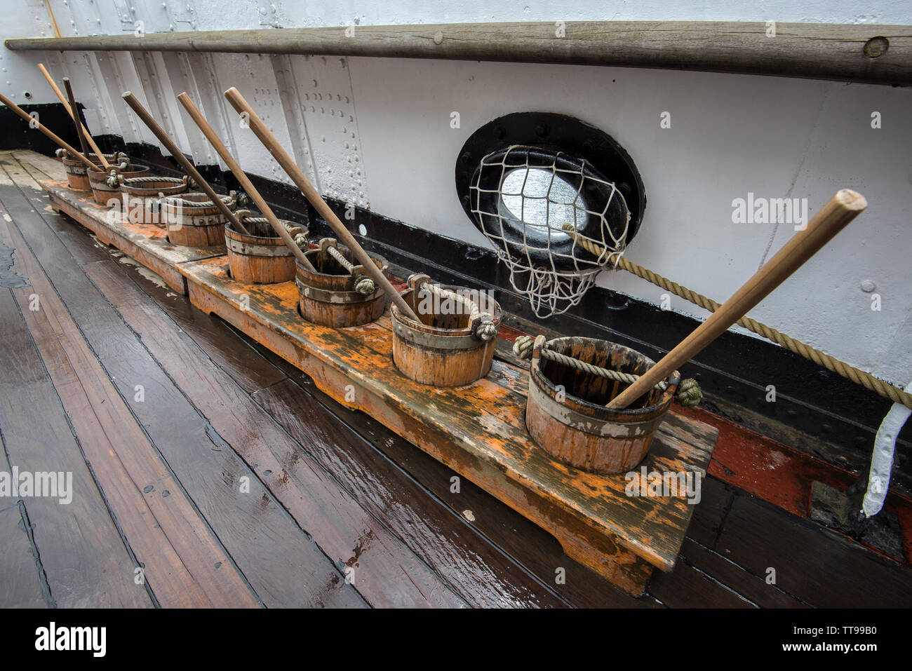 Deck scrubbing Glenlee tall ship - Stock Image