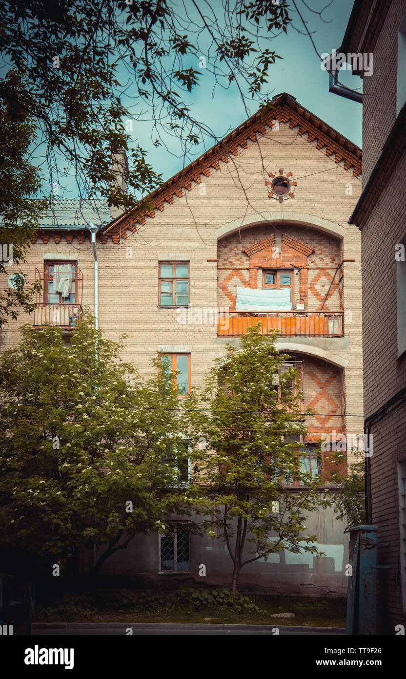 Old brick house in Russia with orange balconies Stock Photo