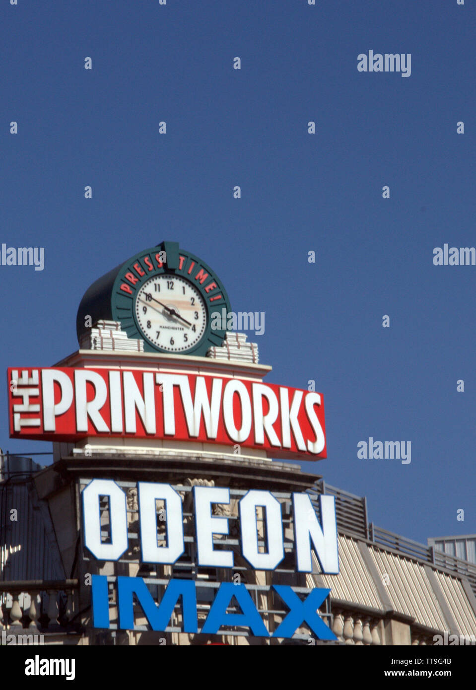 Printworks sign and clock on the roof of the Printworks entertainment complex in city centre Manchester, uk - Stock Image