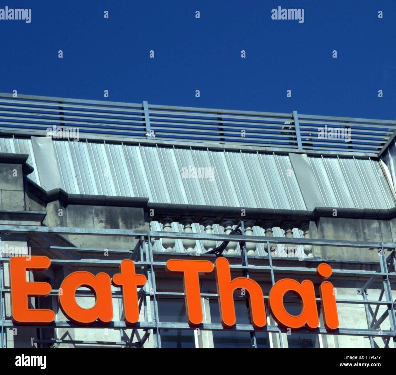 An 'Eat Thai' restaurant sign in city centre Manchester, uk - Stock Image