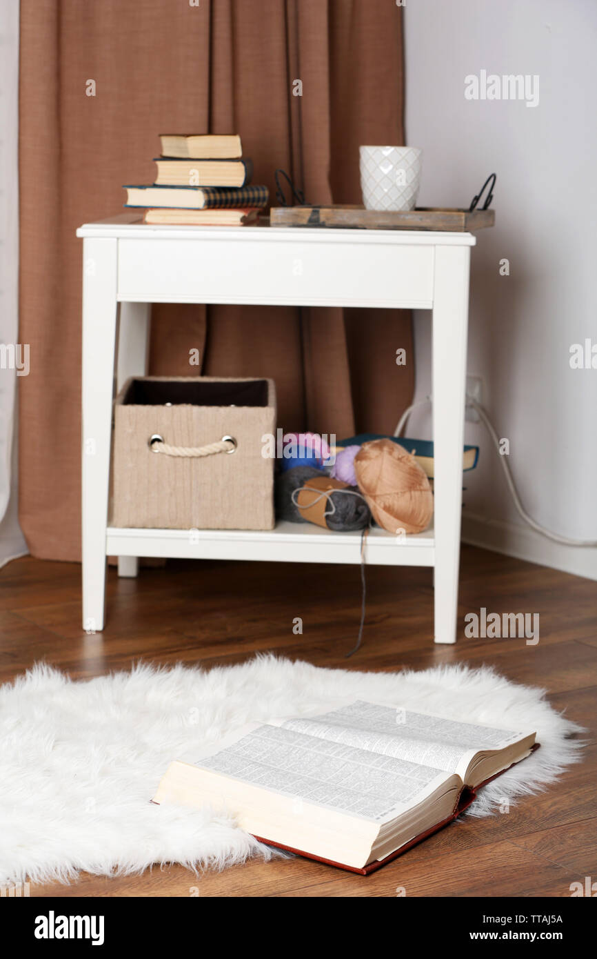 Small coffee table in room - Stock Image