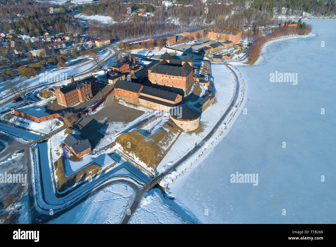 Above the ancient fortress of the  Hameenlinna city on a sunny March day (aerial photography). Finland Stock Photo