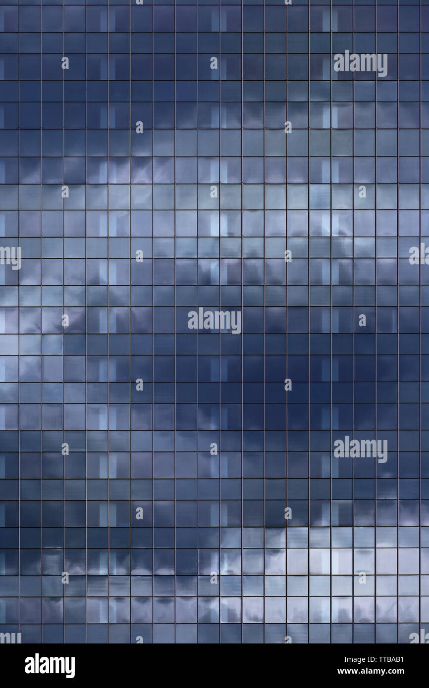 modern office building elevation. glass curtain wall repeating pattern reflecting cloud in the sky. city people in the architectural box. Stock Photo
