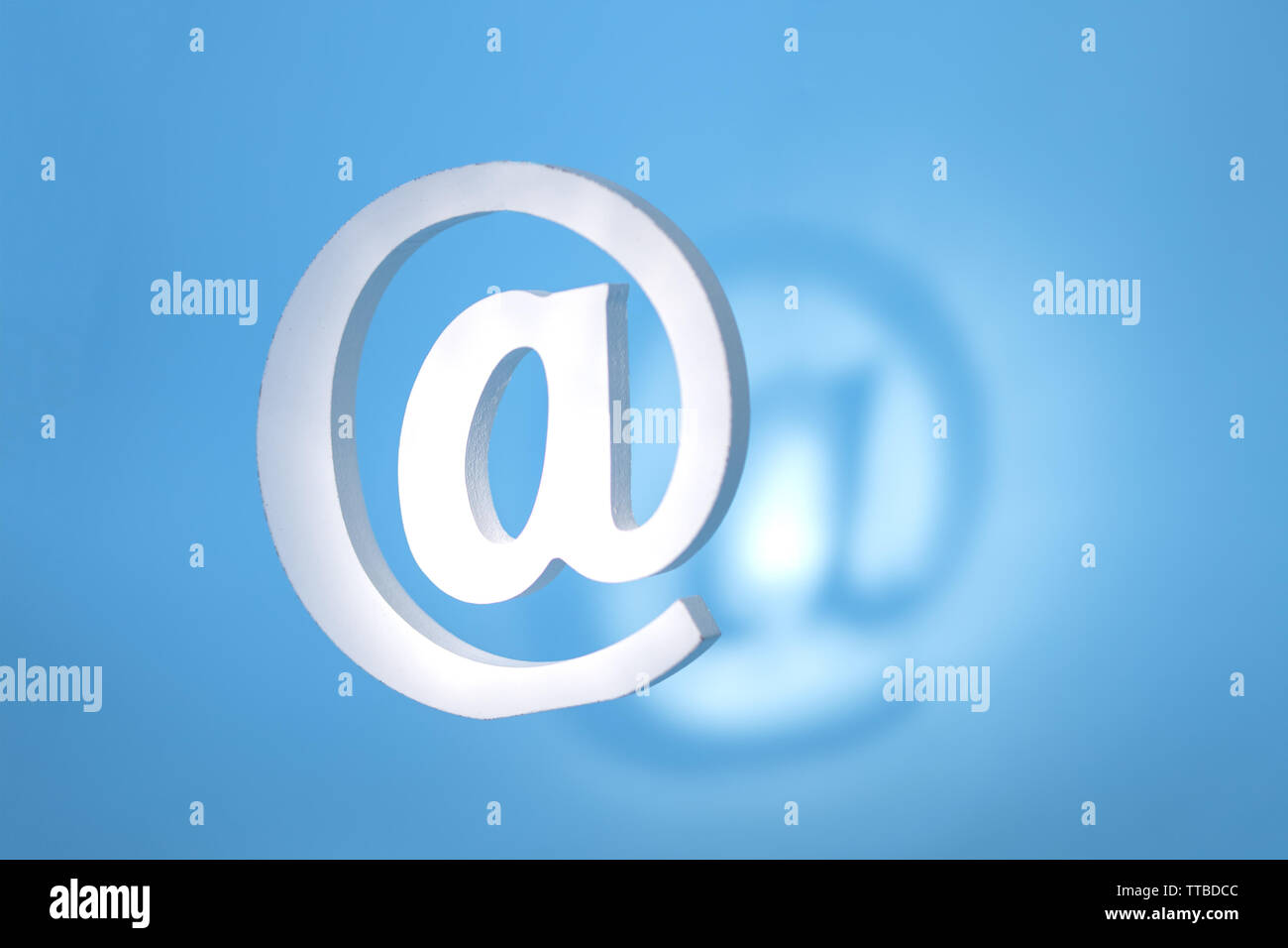 floating email sign on blue background with real shadow. Concept for email, communication or contact us - Stock Image