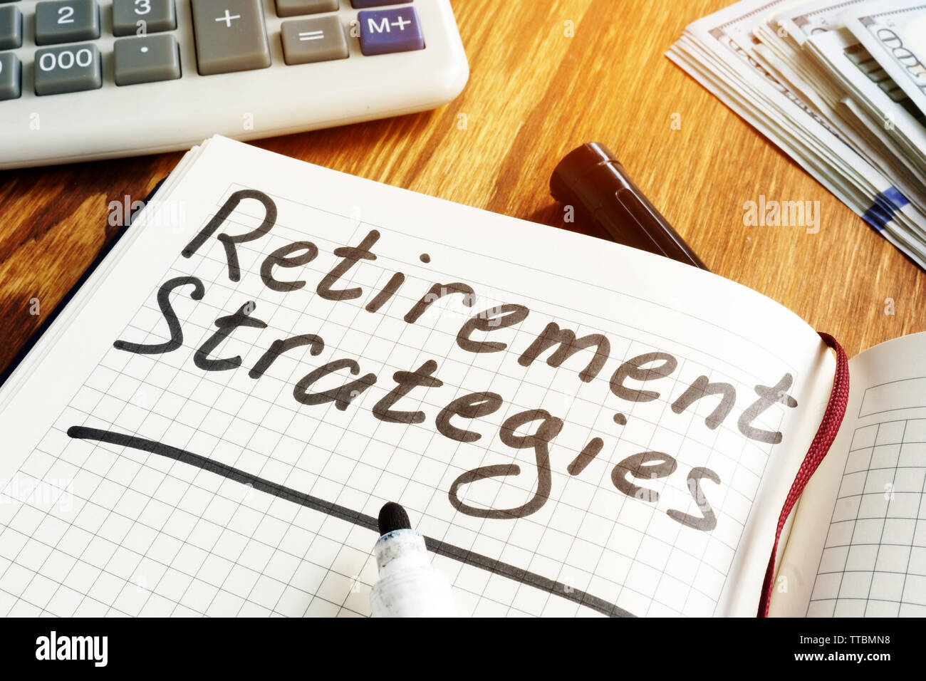 Retirement strategies and pension plan concept. Notebook and pen. - Stock Image