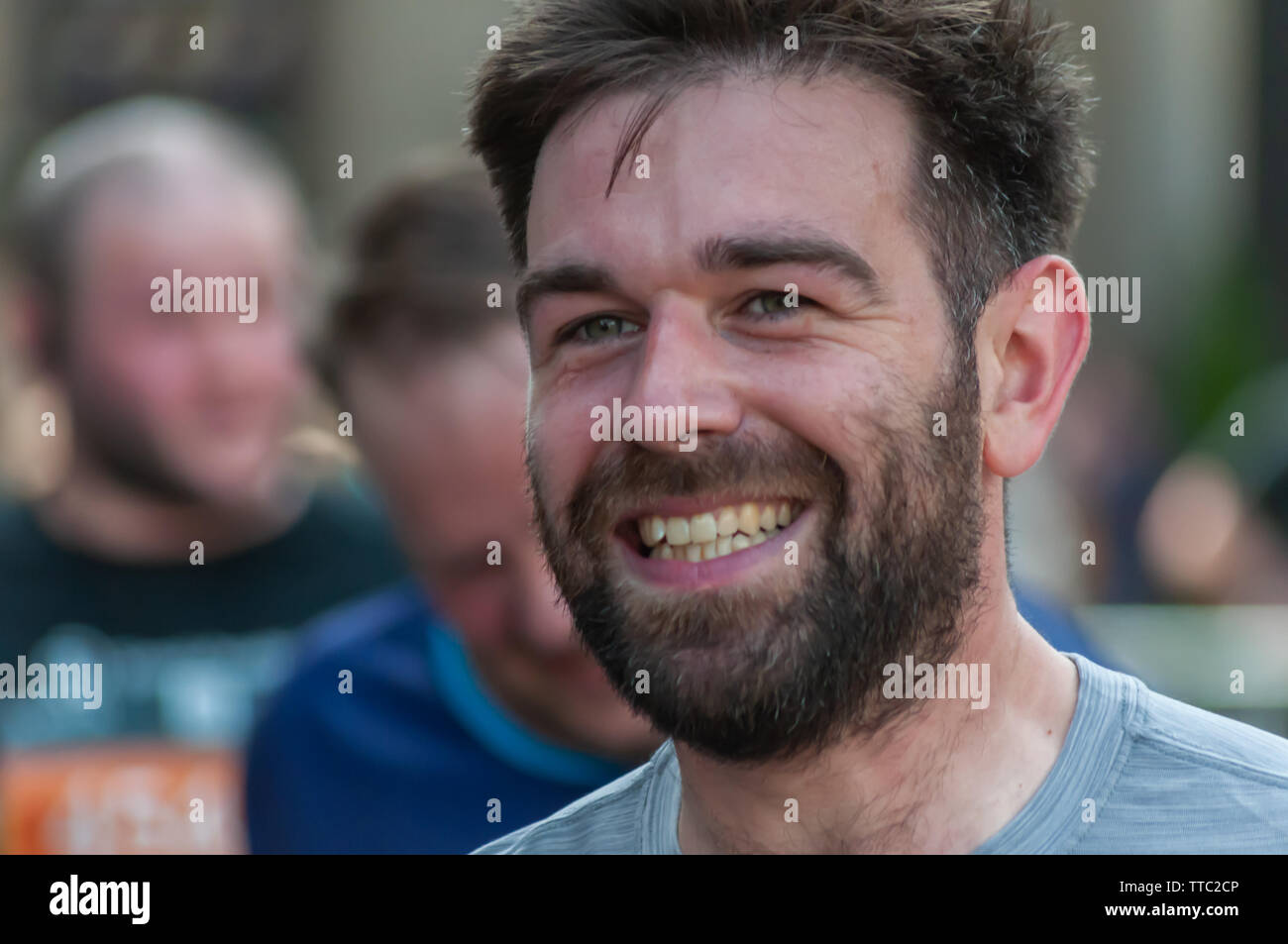 Glasgow, Scotland, UK. 16th June, 2019. A runner at George Square during the Men's 10K Run which has been an annual event since 2004. Thousands of runners take to the streets of the city to get fit, fundraise, and raise awareness of men's health issues. The run coincides with Fathers Day and starts at the Riverside Museum and  finishes at George Square. Credit: Skully/Alamy Live News - Stock Image