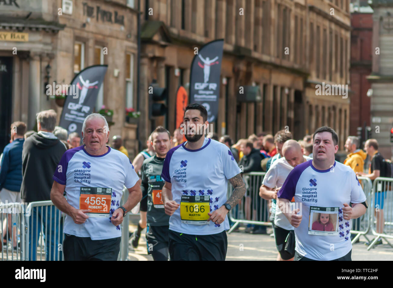 Glasgow, Scotland, UK. 16th June, 2019. Runners at George Square during the Men's 10K Run which has been an annual event since 2004. Thousands of runners take to the streets of the city to get fit, fundraise, and raise awareness of men's health issues. The run coincides with Fathers Day and starts at the Riverside Museum and  finishes at George Square. Credit: Skully/Alamy Live News - Stock Image