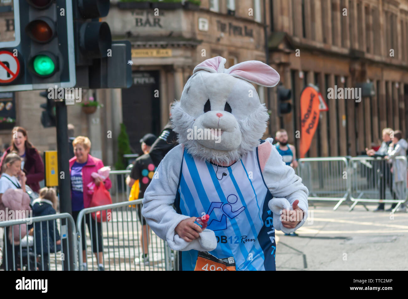 Glasgow, Scotland, UK. 16th June, 2019. A runner dressed in a rabbit costume during the Men's 10K Run which has been an annual event since 2004. Thousands of runners take to the streets of the city to get fit, fundraise, and raise awareness of men's health issues. The run coincides with Fathers Day and starts at the Riverside Museum and  finishes at George Square. Credit: Skully/Alamy Live News - Stock Image