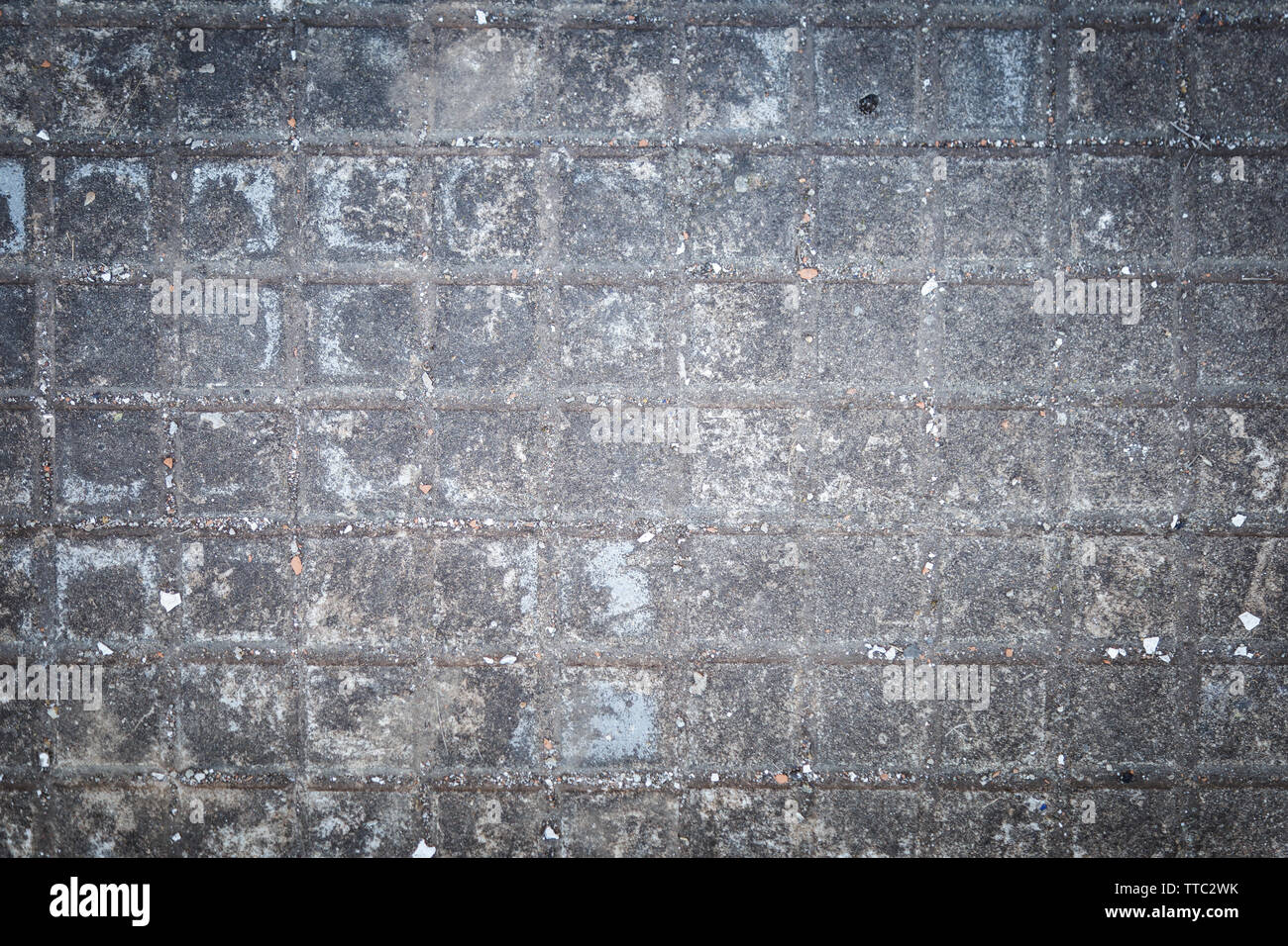 Gray and aged cement floor in an abandoned place Stock Photo