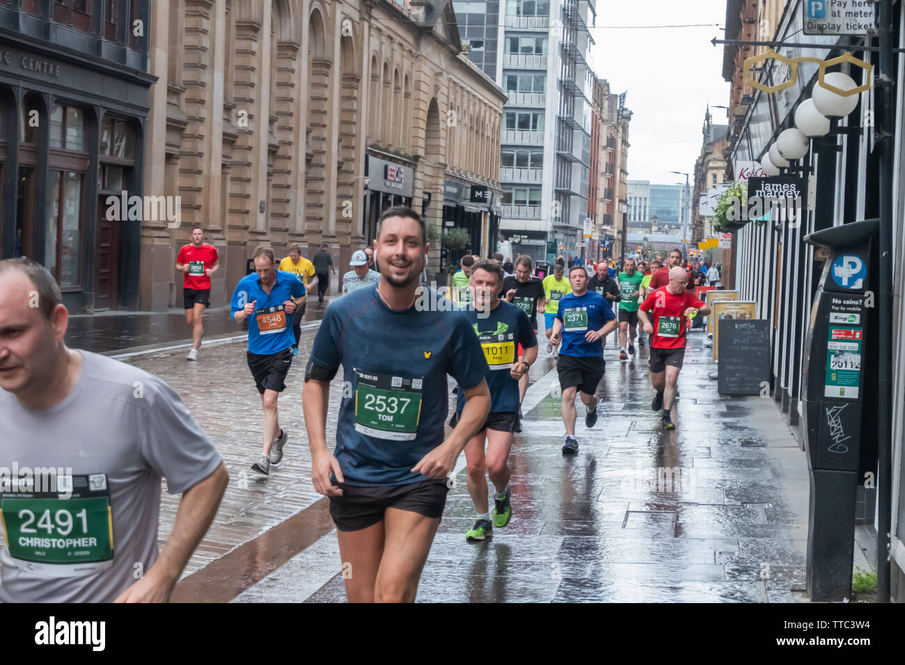 Glasgow, Scotland, UK. 16th June, 2019. Runners at Candelriggs during the Men's 10K Run which has been an annual event since 2004. Thousands of runners take to the streets of the city to get fit, fundraise, and raise awareness of men's health issues. The run coincides with Fathers Day and starts at the Riverside Museum and  finishes at George Square. Credit: Skully/Alamy Live News - Stock Image