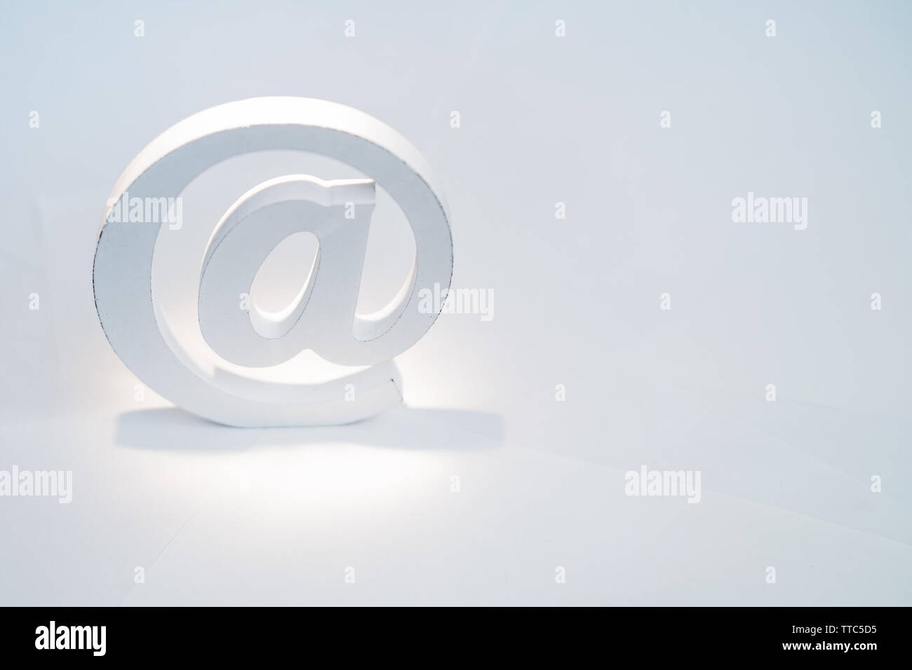 Email sign on white background with real shadow. Concept for email, communication or contact us - Stock Image