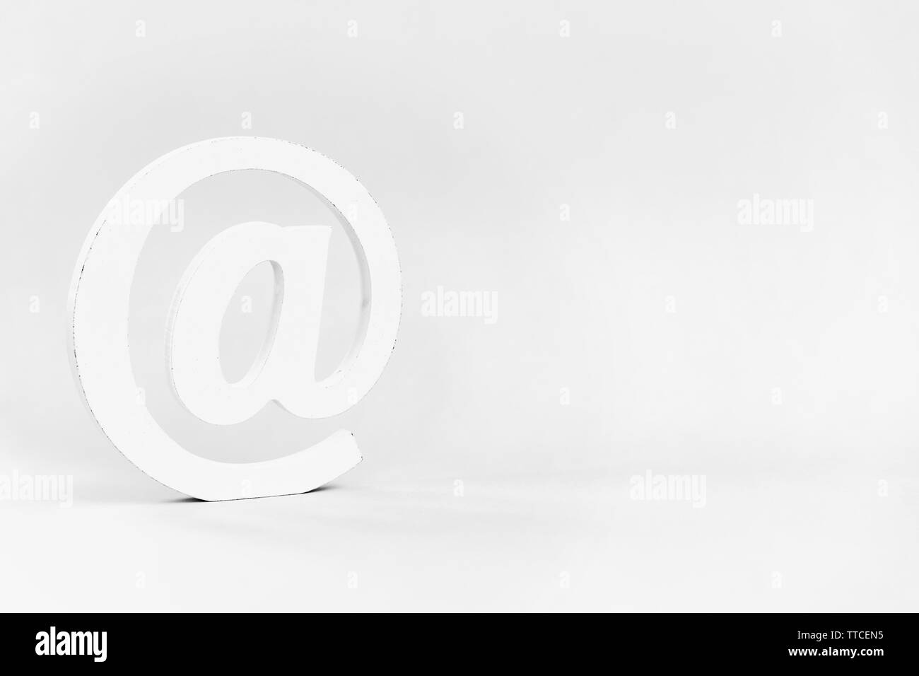 Email sign on blue background. Concept for email, communication or contact us - Stock Image
