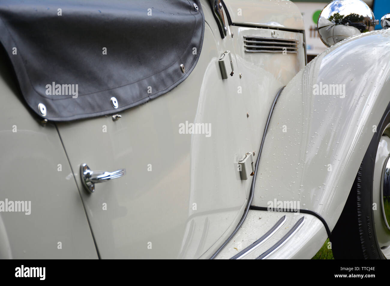 Close up of a Classic Sports Car showing the door, wing and bonnet - Stock Image
