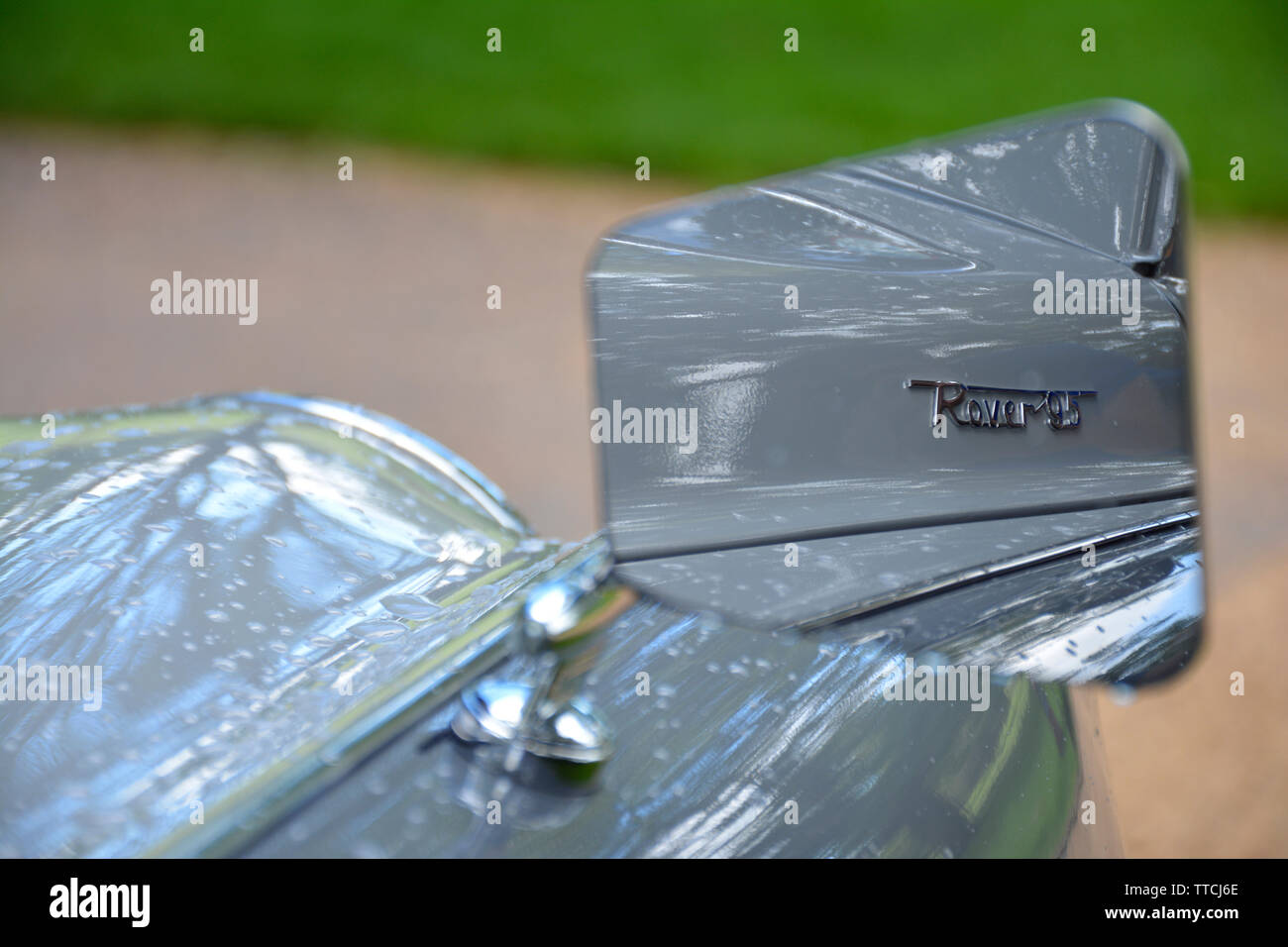 Close up of a Rover 95 Classic Car Showing the Chrome Badge Reflected in the Mirror - Stock Image
