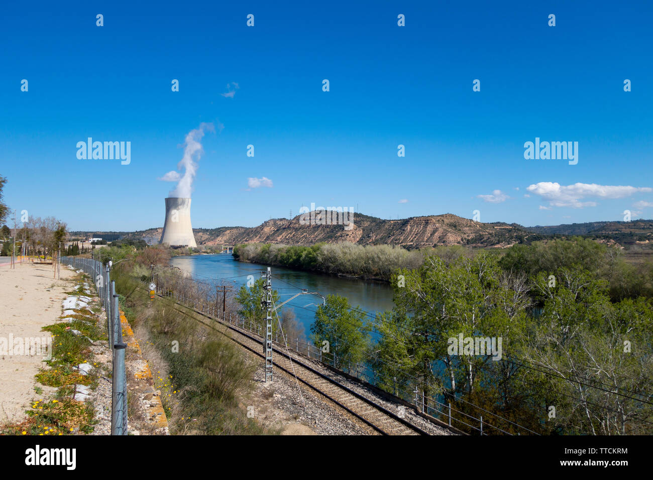 Steam chimney in a power nuclear plant, next to the river - Stock Image