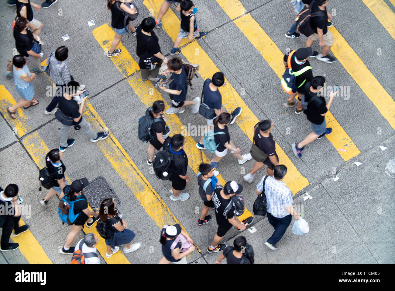 Hong Kong, Hong Kong. 16 June, 2019.  Protesters crossing streets in Tin Hau to gather for protests on Sunday against the governments introduction of a contentious law and the handling of subsequent protests. Credit: Danny Tsai/Alamy Live News Stock Photo