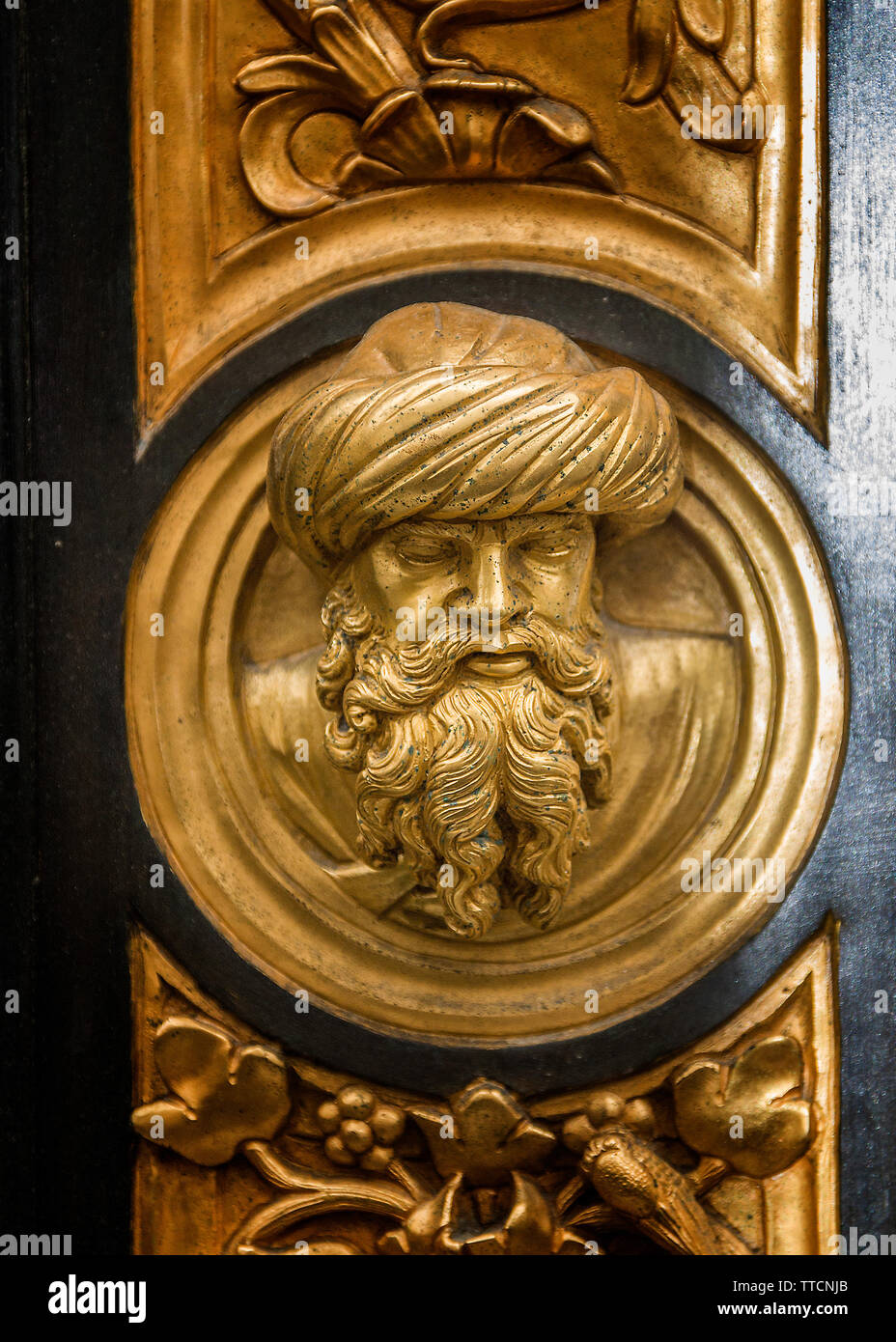 Italy, Florence. Bronze, gilt-coated doors of the Baptistery of San Giovanni - 'The Gates of Paradise', as the great Michelangelo called them. Fragmen - Stock Image