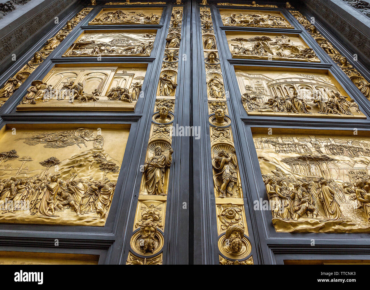 Italy, Florence. Bronze, gilt-coated doors of the Baptistery of San Giovanni - 'The Gates of Paradise', as the great Michelangelo called them. - Stock Image