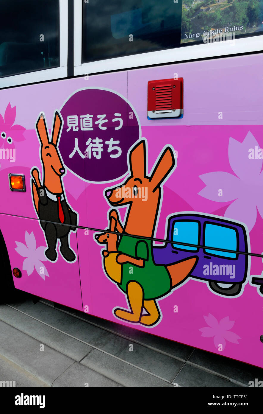 child friendly graphic design on local bus Magome Village Japan - Stock Image