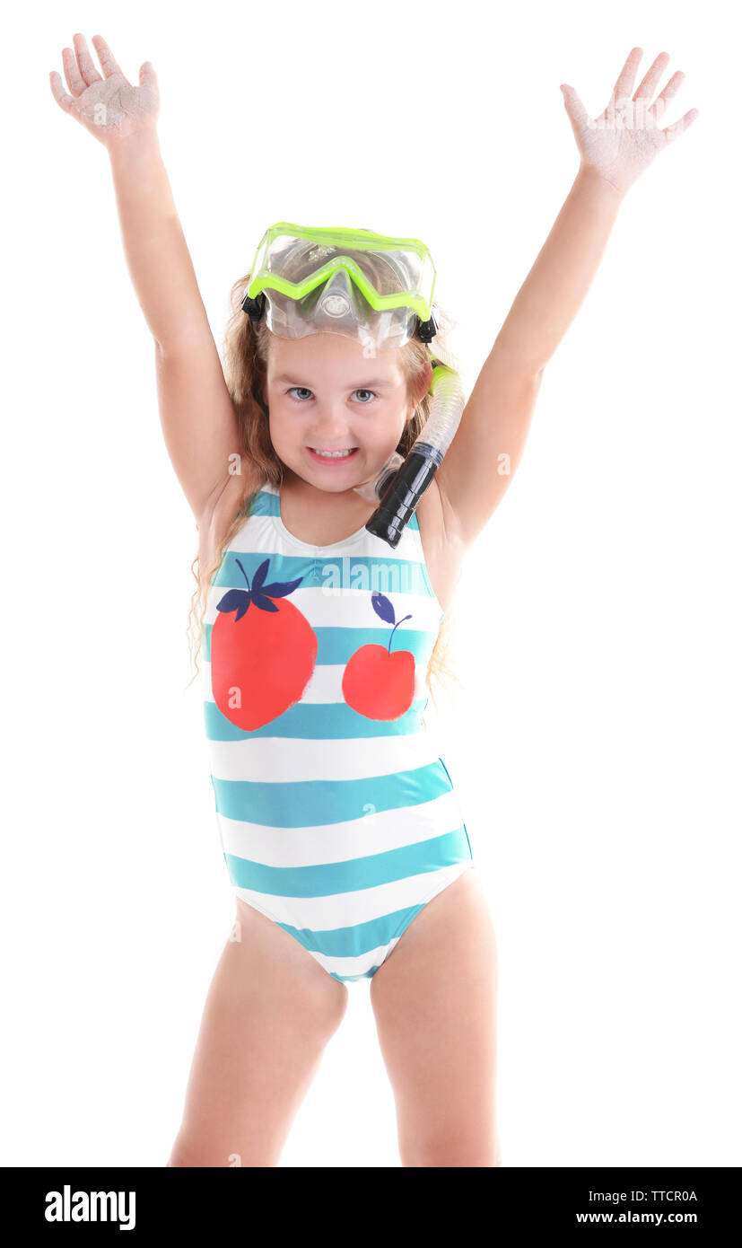 Happy little girl in blue striped swimsuit with diving mask poses on white background - Stock Image