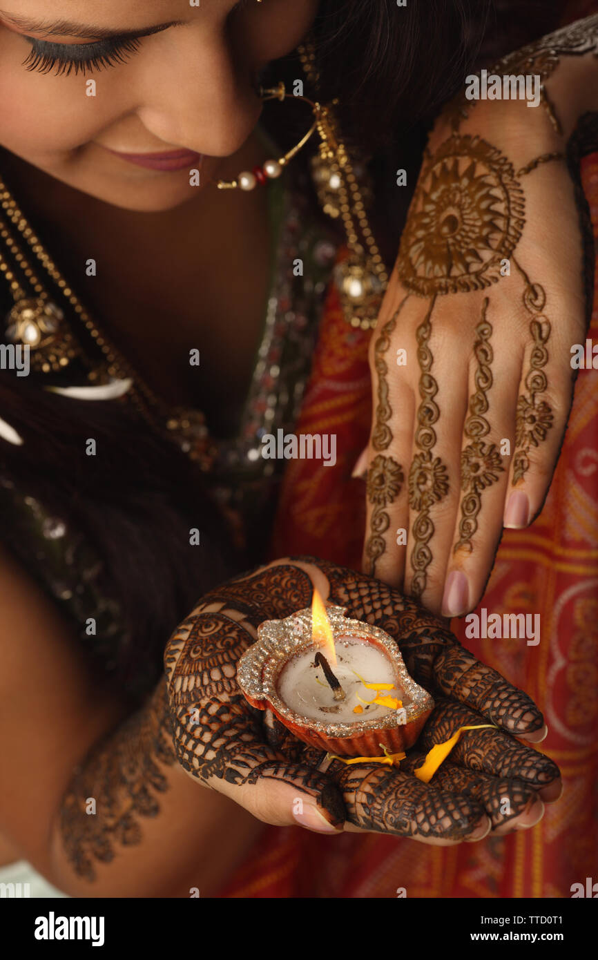 Bride holding an oil lamp on her palm Stock Photo
