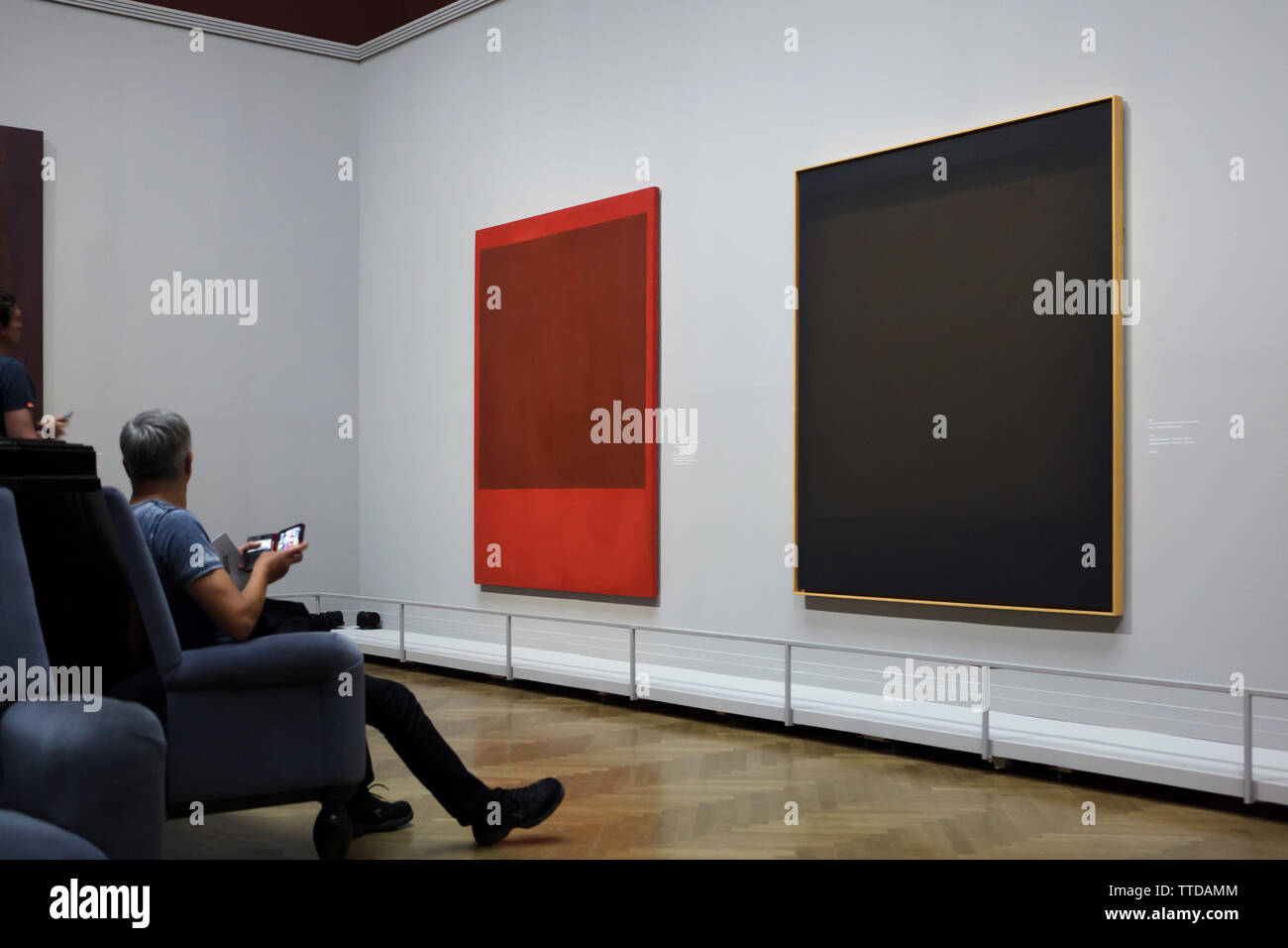 Visitors in front of the paintings by American abstract expressionist painter Mark Rothko displayed at his retrospective exhibition in the Kunsthistorisches Museum (Museum of Art History) in Vienna, Austria. The exhibition runs till 30 June 2019. Stock Photo