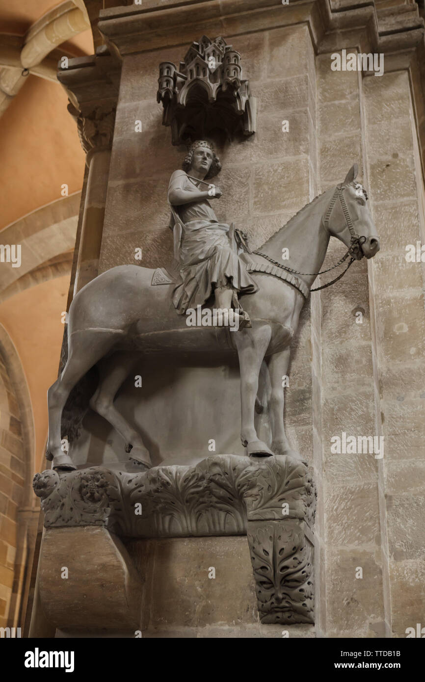 Gothic statue of the Bamberg Horseman (Bamberger Reiter) in the Bamberg Cathedral (Bamberger Dom) in Bamberg, Upper Franconia, Germany. The statue, possibly depicting the Hungarian king Stephen I, most likely dates to the period from 1225 to 1237. Stock Photo