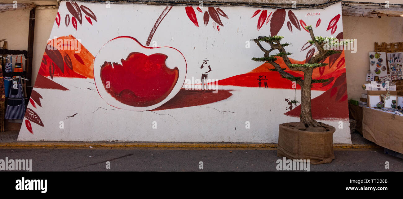 Graphic art painting of a cherry to commemorate the festival of cherries in Spain - Stock Image