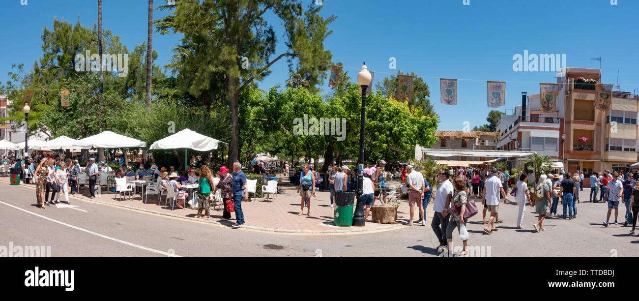 Village scene of people walking round the Salsadella cherry festival to celebrate the cherry season - Stock Image