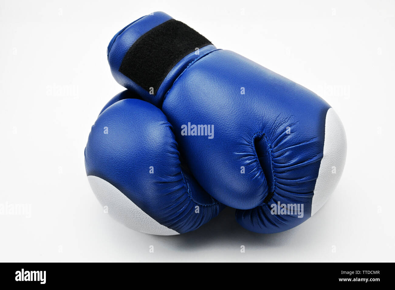 Blue boxing gloves on an isolated white background.Mitten - Stock Image
