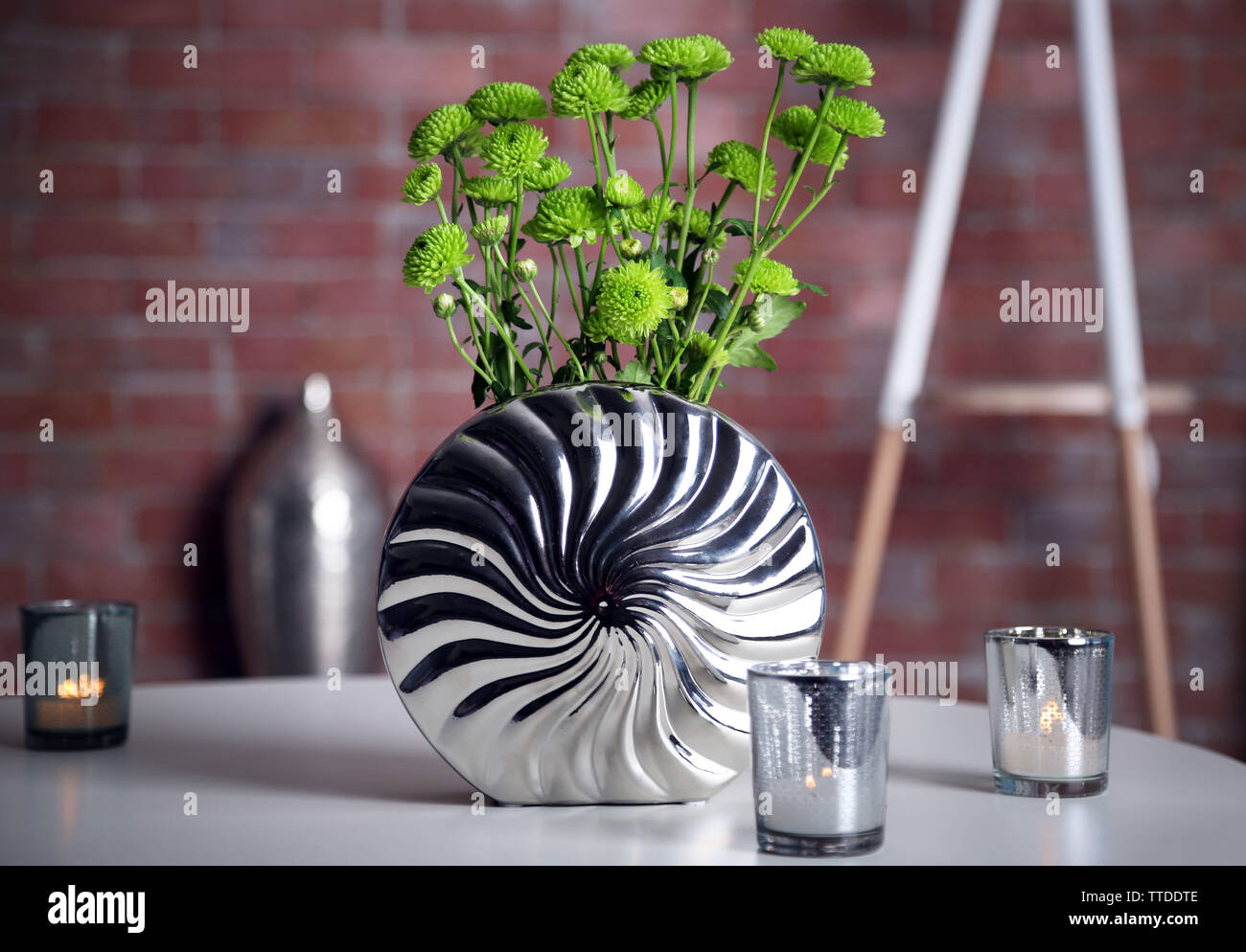 Home decor in a room on a brick wall background - Stock Image
