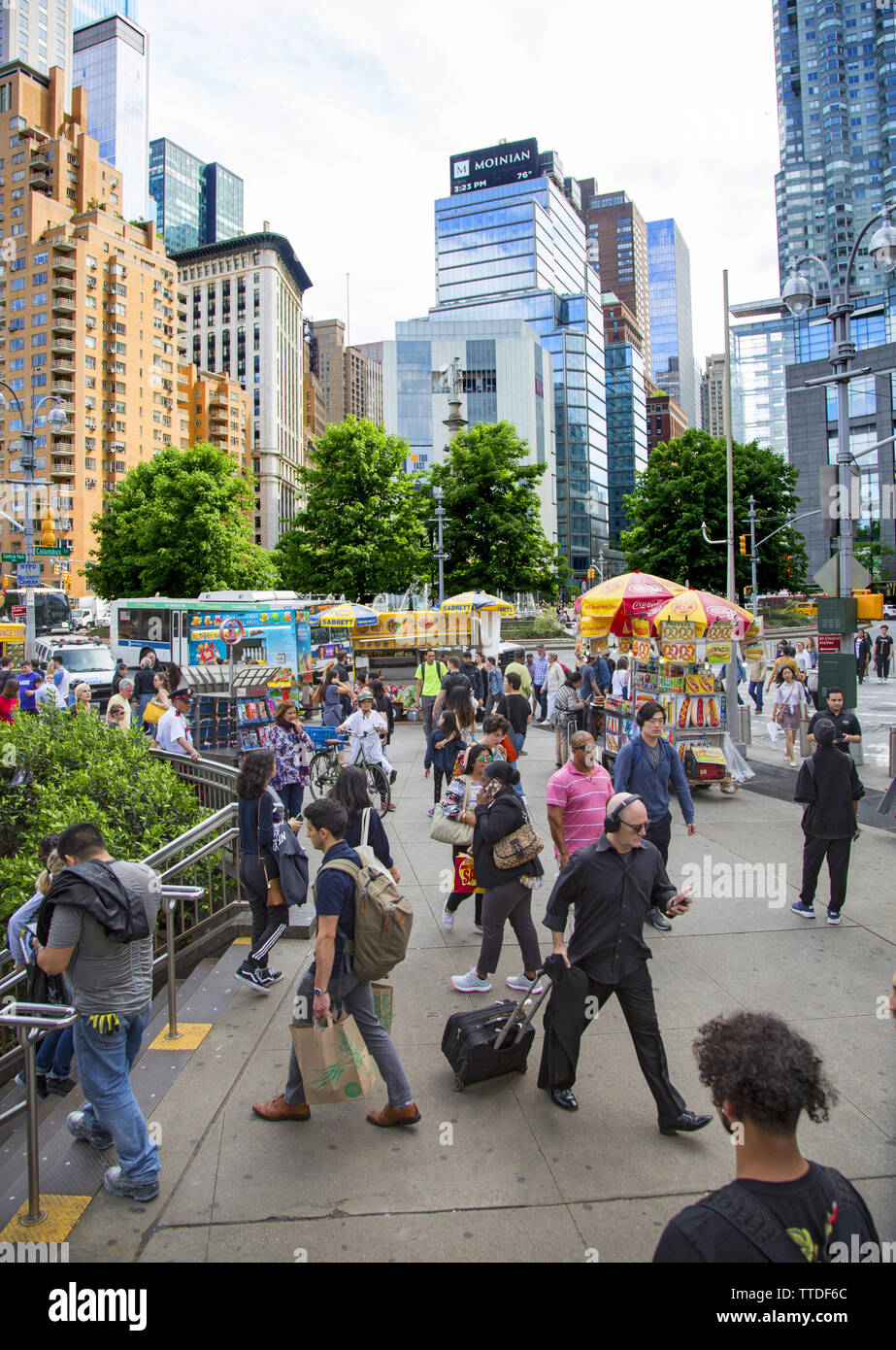 The southwest corner of Central Park at Columbus Circle is always busy with park goers and tourists. Stock Photo