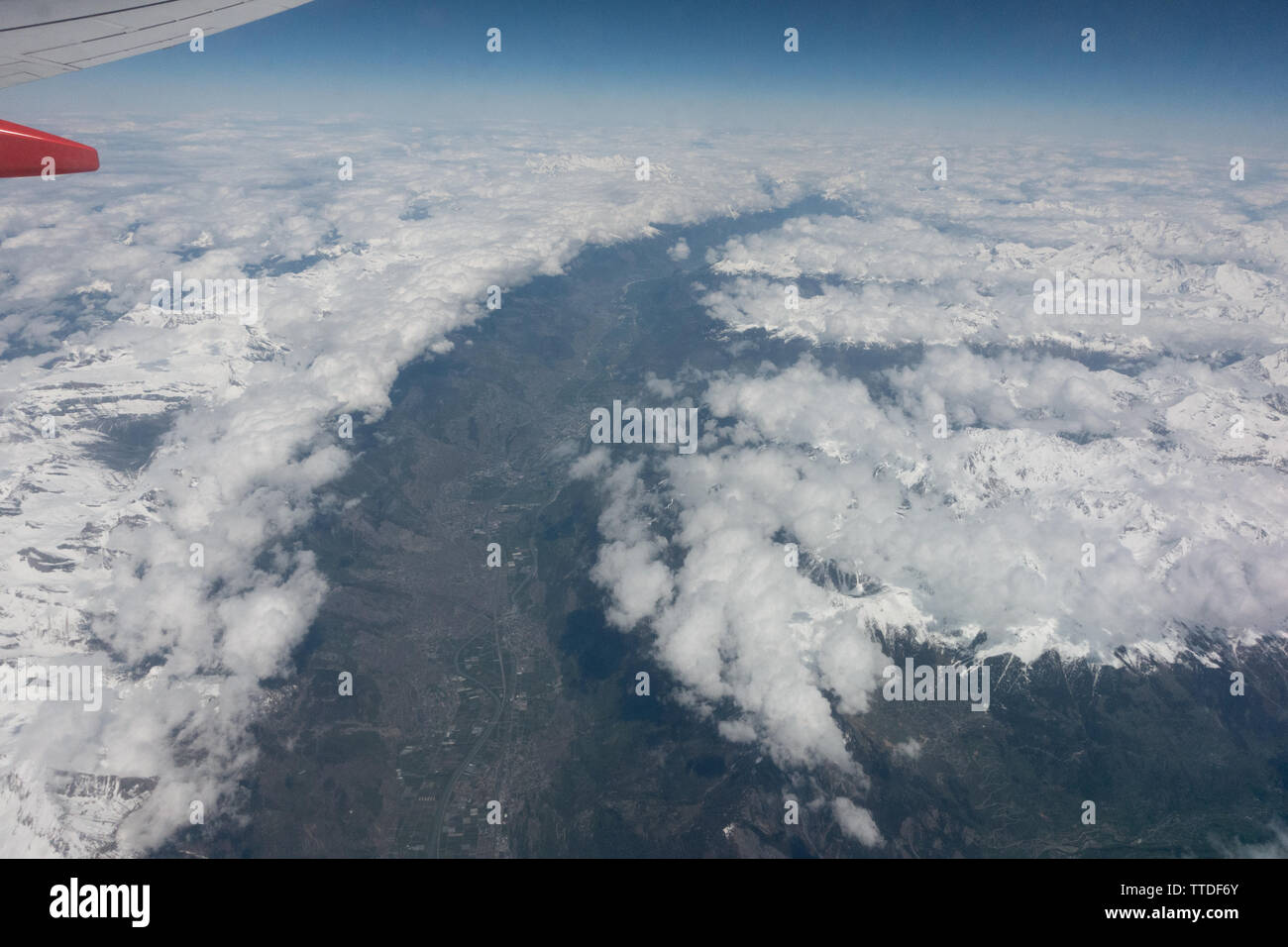 View from a cabin window of a Boeing 737 above the clouds Stock Photo