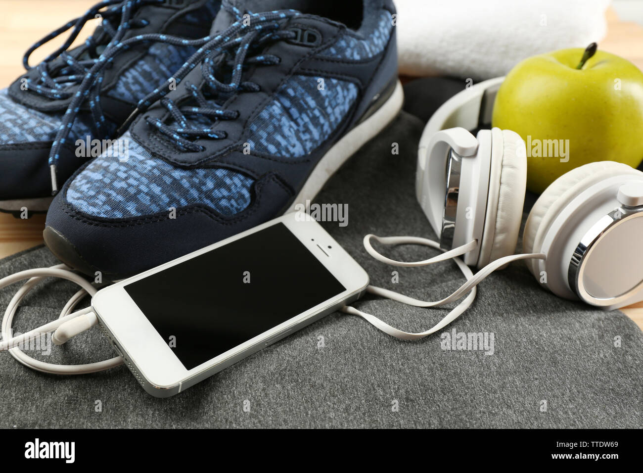 Sport clothes and equipment on wooden background - Stock Image