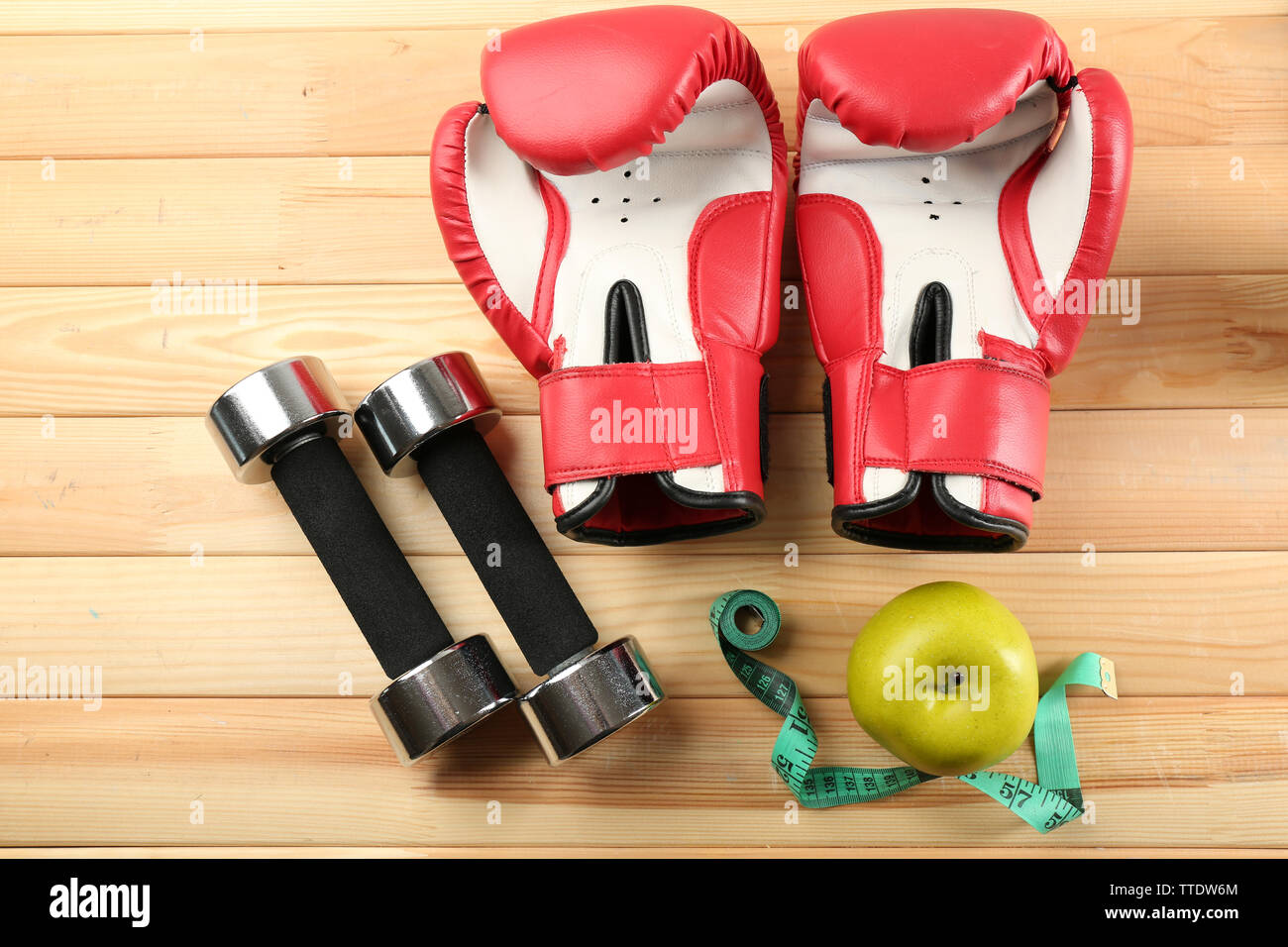 Sport equipment on wooden background - Stock Image