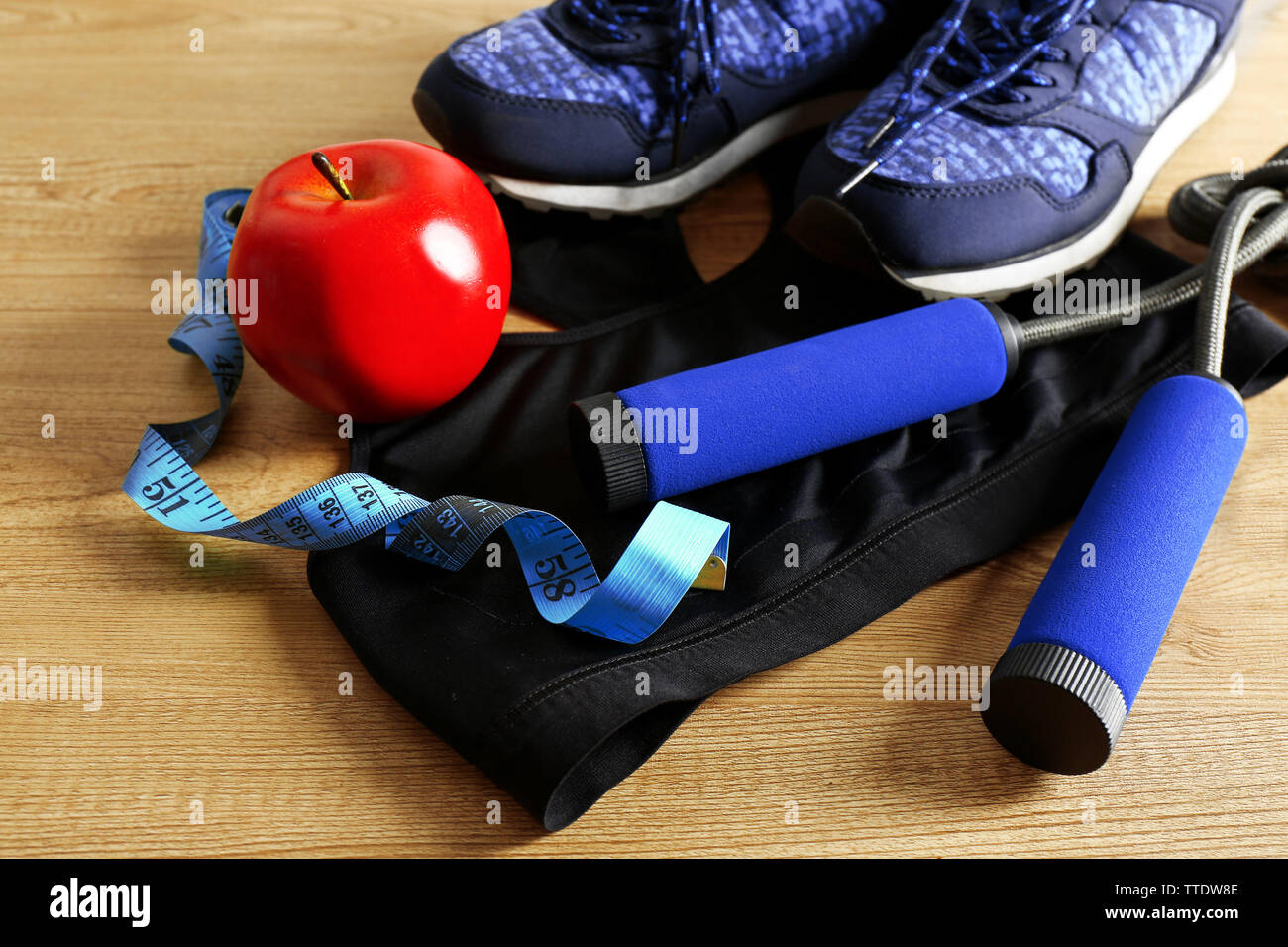 Sport shoes, clothes, equipment on light background - Stock Image