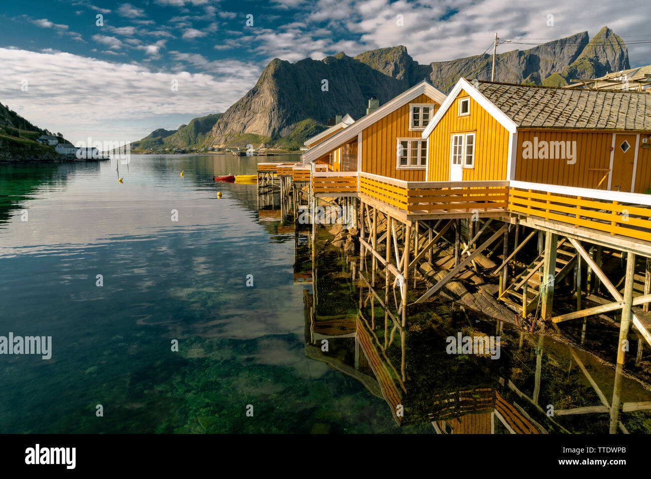 Beautiful view of scenic Lofoten Islands archipelago winter scenery with traditional yellow fisherman Rorbuer cabins in the historic village of Sakris Stock Photo