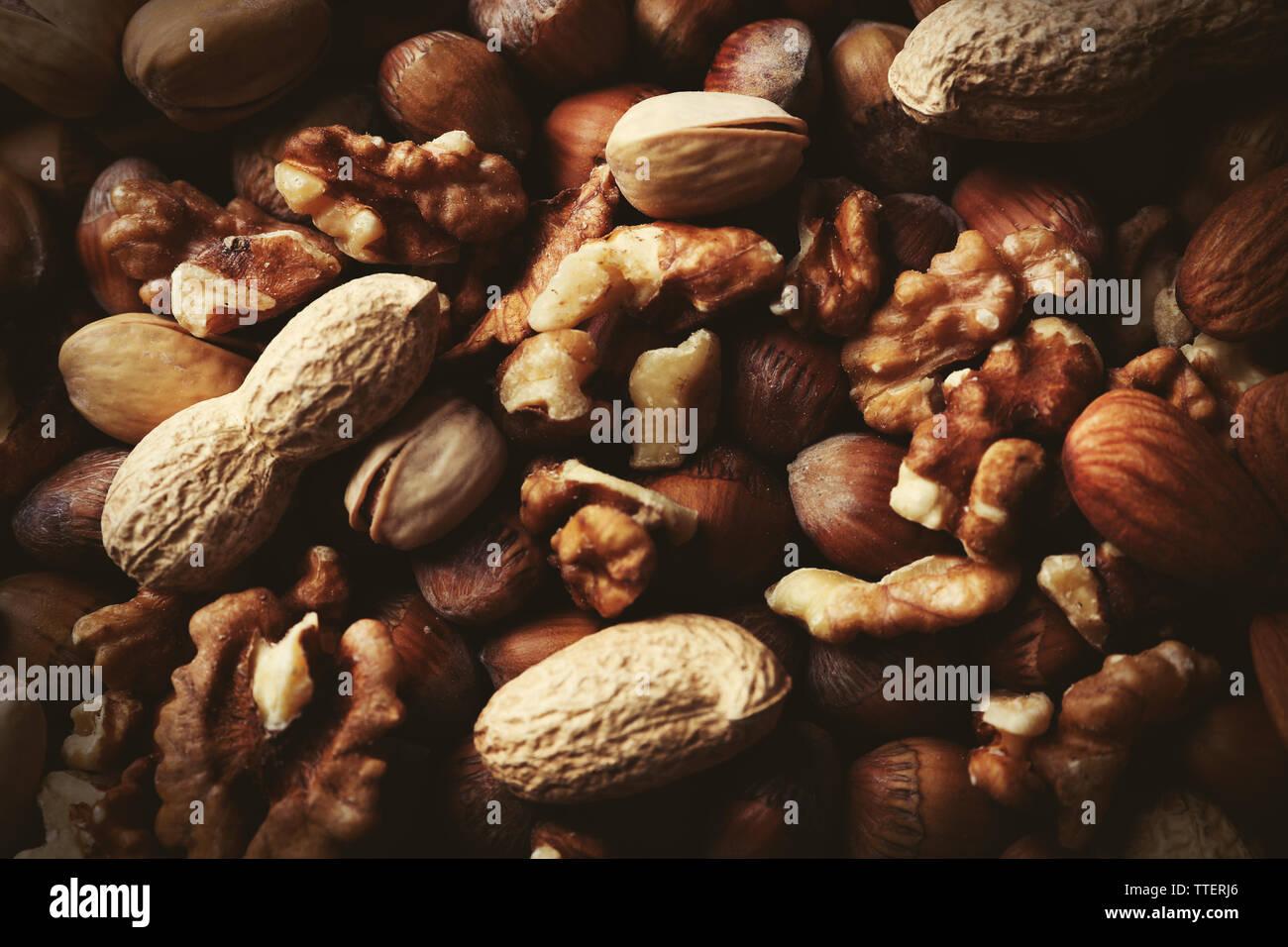 Background of hazelnuts, pistachios, walnuts, almonds, acorns and peanuts Stock Photo