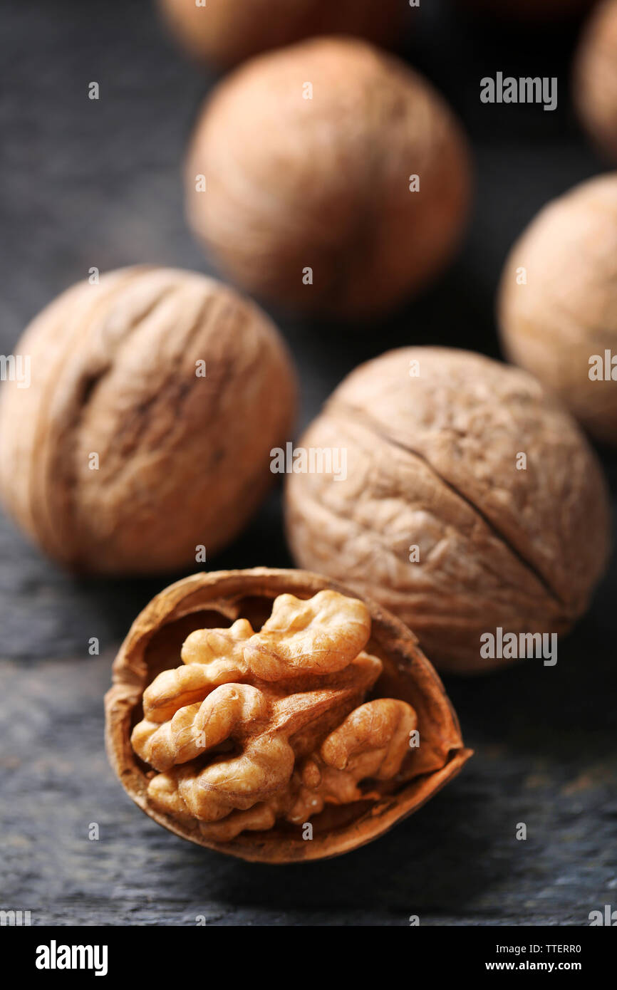 Walnuts on grey wooden table, close-up Stock Photo
