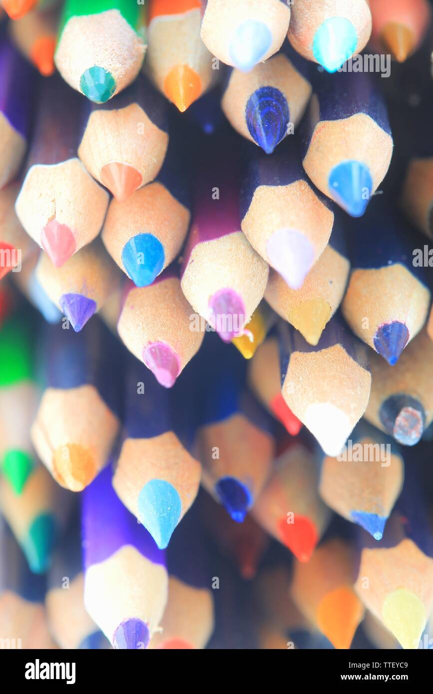 color pencils group together. multi-color. creative art and student kid activities education. multi cultural and diversity theme. Stock Photo