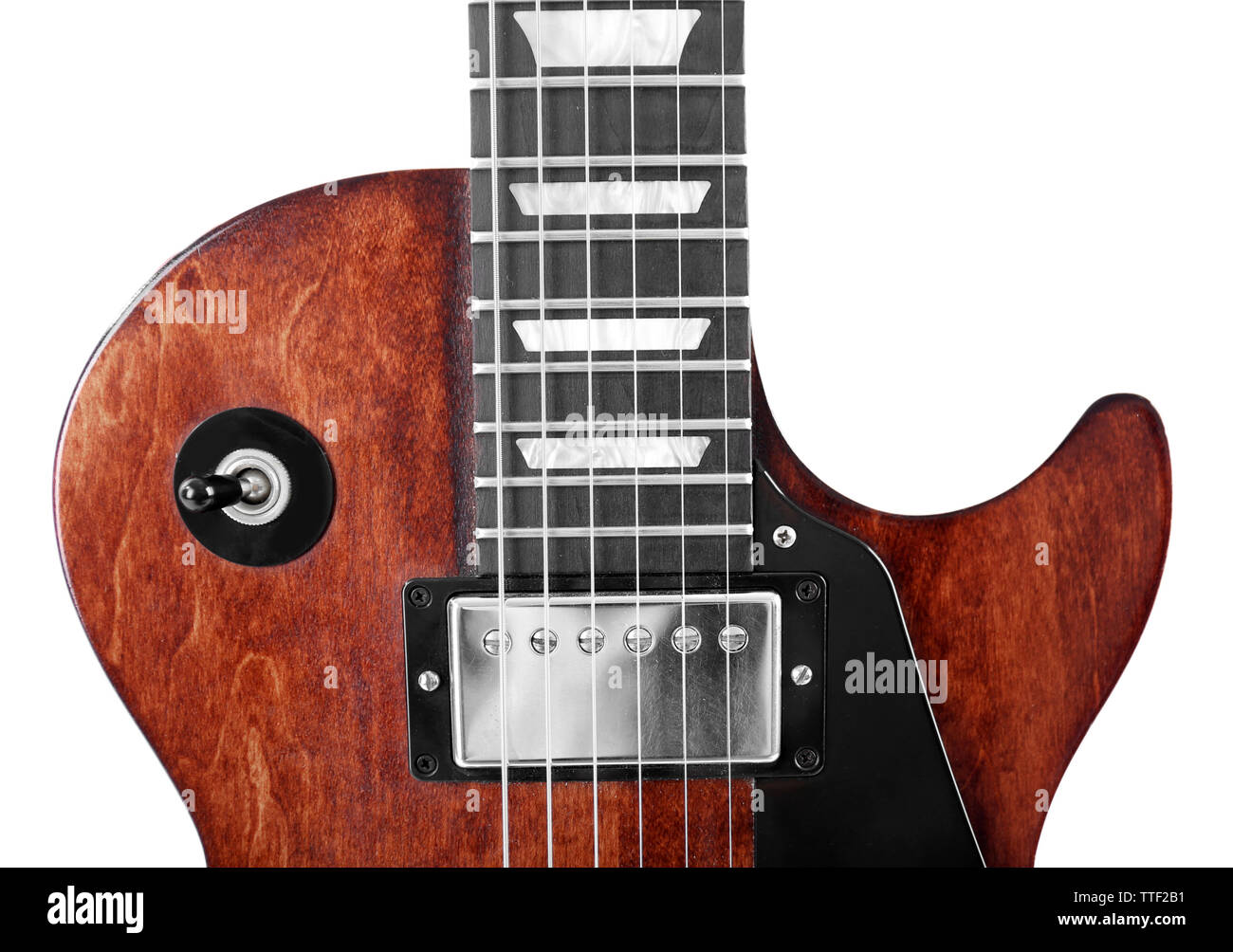 Toggle switch and neck of brown electric guitar, isolated on white - Stock Image