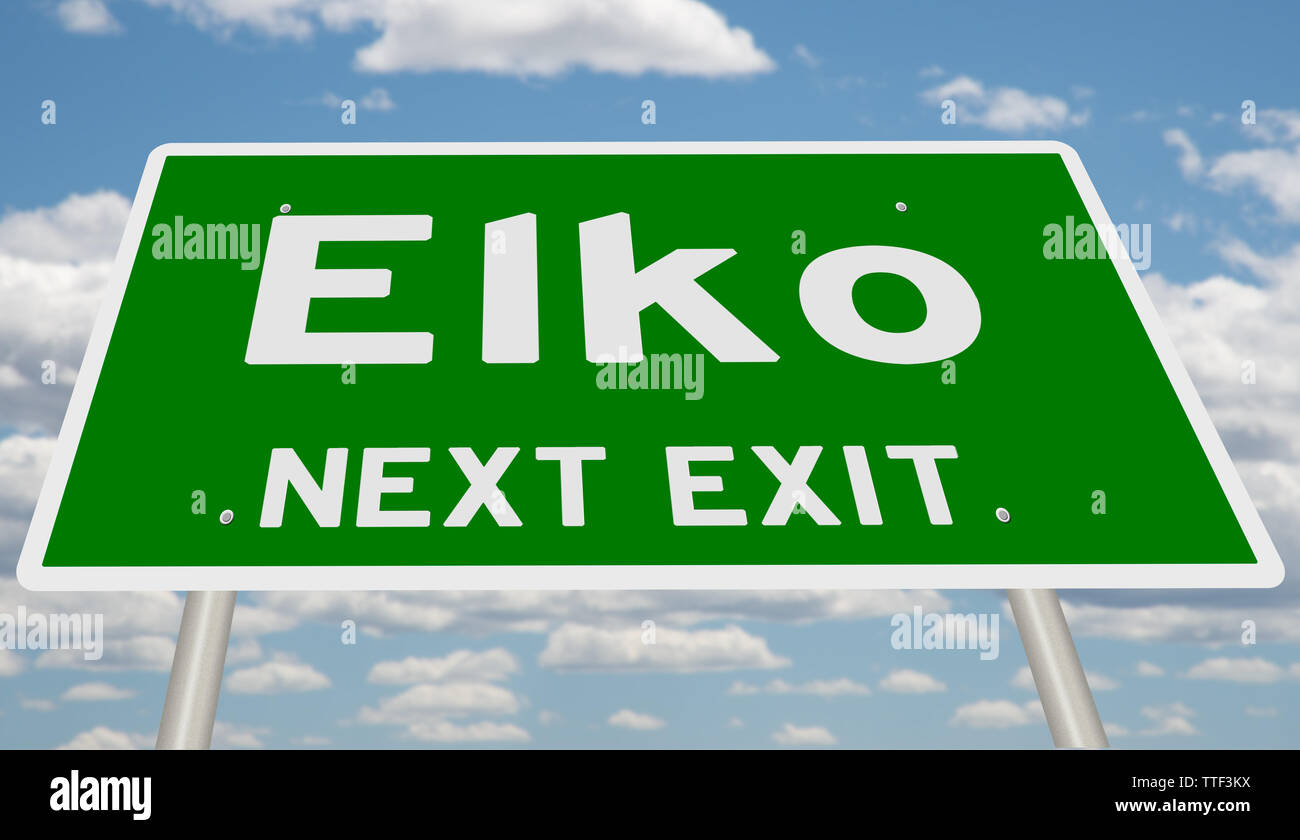 Green highway sign for Elko, next exit - Stock Image